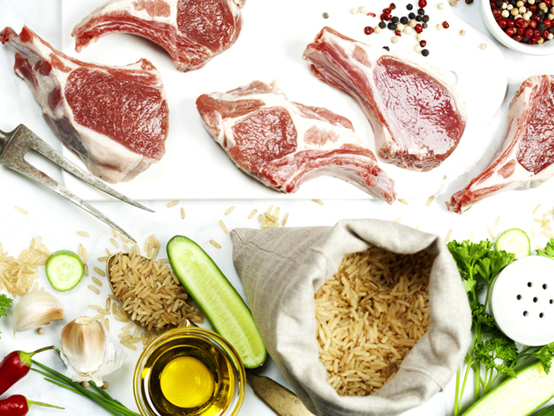 Brown rice and Raw lamb chops - cooking or healthy eating concept