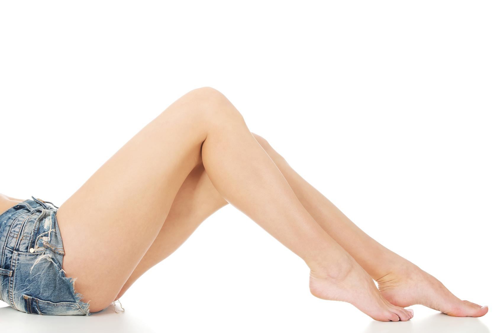 Slim woman legs in jeans shorts.